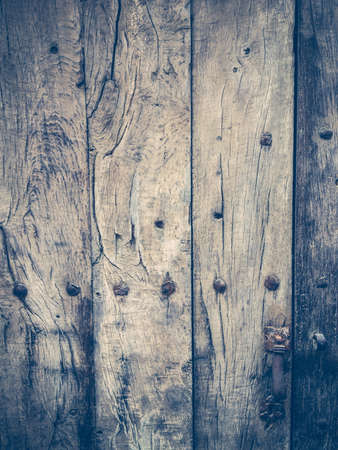 Old wooden door with metal door knob photo