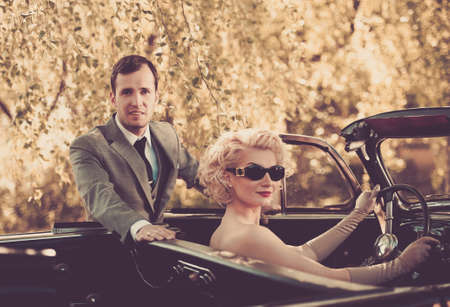 classic car: Retro couple and convertible