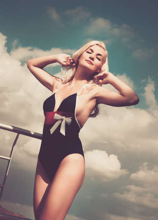 clothes pins: Pin up girl near swimming pool Stock Photo