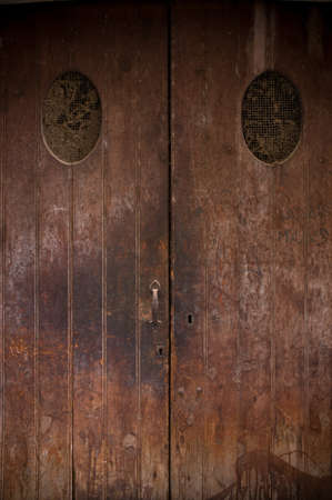 door bolt: Old wooden grunge door Stock Photo
