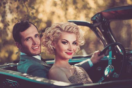 convertible car: Retro couple in convertible