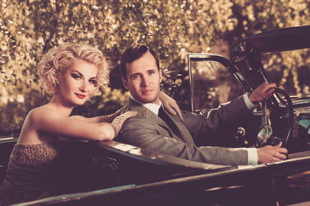 Retro couple in convertible Stock Photo - 16305206