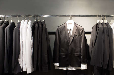menswear: Row of suits in shop