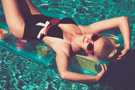 Pin up girl in the swimming pool photo