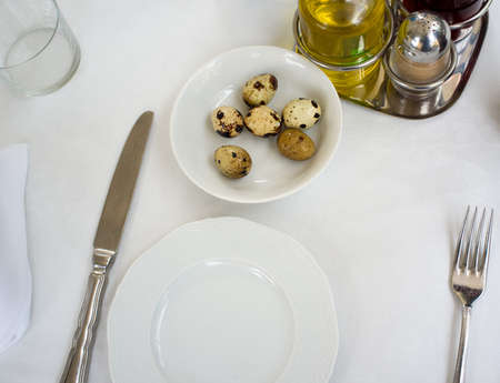 Plate with quail eggs in restaurant photo