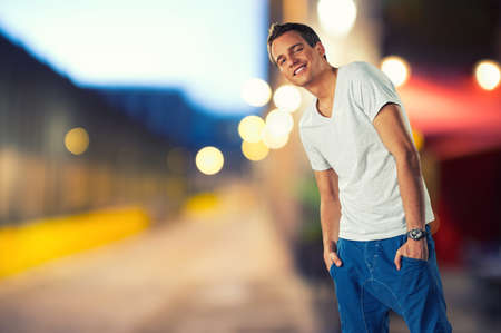 Stylish young man over blurred background photo