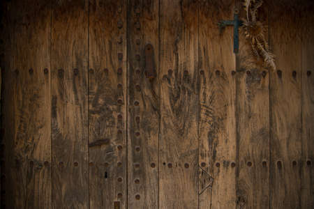 wicket door: Old wooden door with metal knobs background Stock Photo