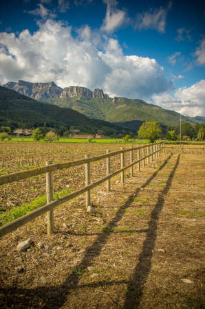 wood fence: Small wooden fence in field Stock Photo