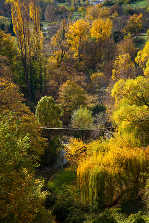 Old bridge over river in autumn landscape Stock Photo - 16611613