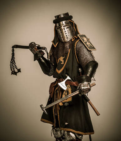 Medieval knight with different weapon photo