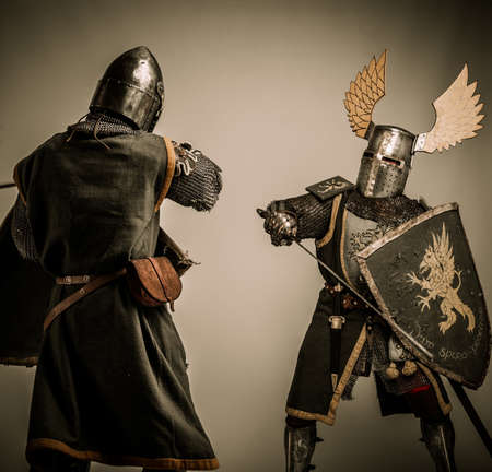 Fight between two medieval knight photo