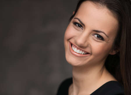nice face: Young brunette woman with beautiful smile Stock Photo