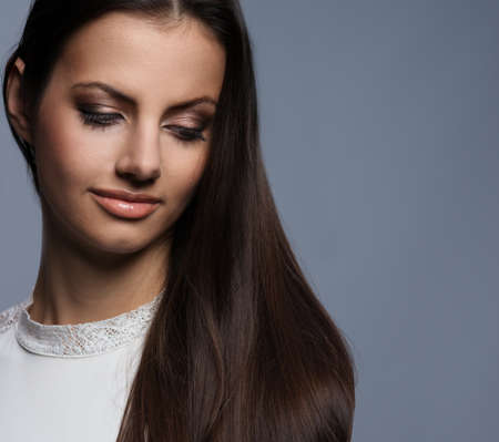 Pensive young woman with beautiful hair photo