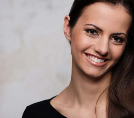 Young brunette woman with beautiful smile photo