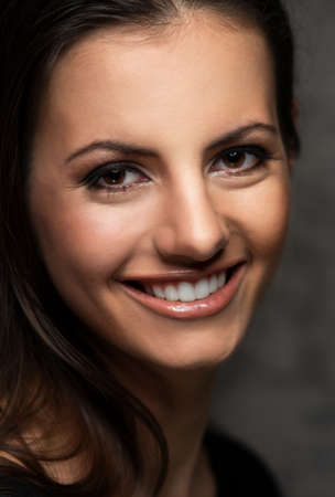 a tooth are beautiful: Young brunette woman with beautiful smile Stock Photo