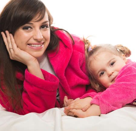 dressing gowns: Happy mother and daughter in dressing gowns