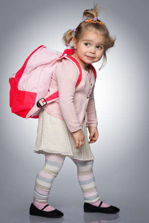 school bag: Funny little girl with backpack