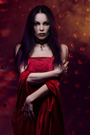 sexy vampire: Beautiful vampire woman in red dress