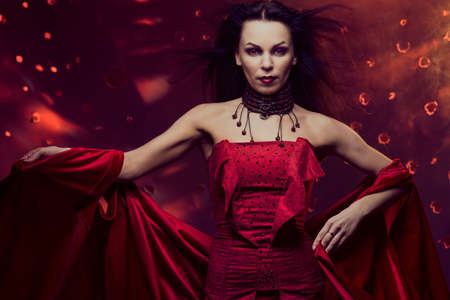 sexy witch: Beautiful vampire woman in red dress