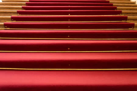Red carpet on wooden steps Stock Photo