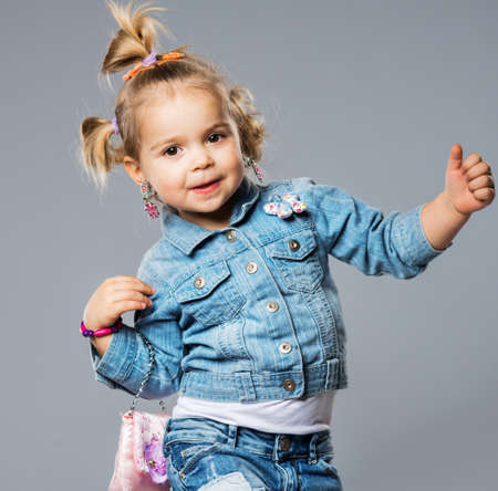 studio shots: Funny little girl with small bag Stock Photo