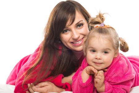 bath gown: Happy mother and daughter in dressing gowns