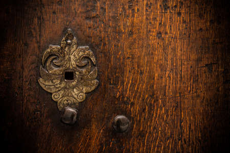 Keyhole on old wooden door Stock Photo - 17652799