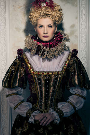 Haughty queen in royal dress  Stock Photo - 17846574