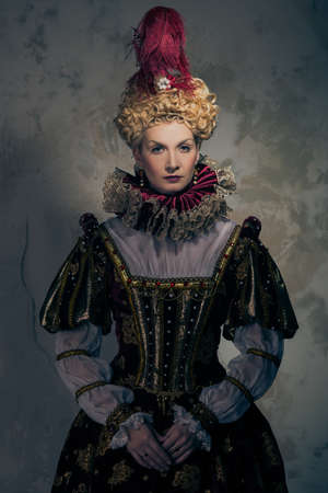 Haughty queen in royal dress  photo