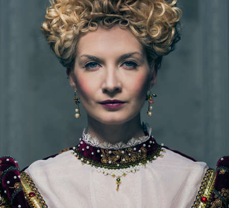 Portrait of beautiful haughty queen photo