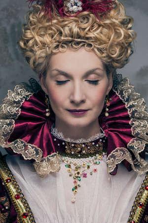 Portrait of beautiful haughty queen photo
