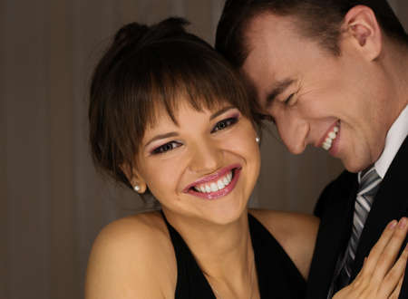 jointly: Happy elegant couple in classic dress