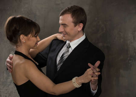 jointly: Young smiling man and woman in elegant evening dress Stock Photo