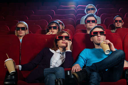 Group of people in 3D glasses watching movie in cinema Stock Photo - 18191978