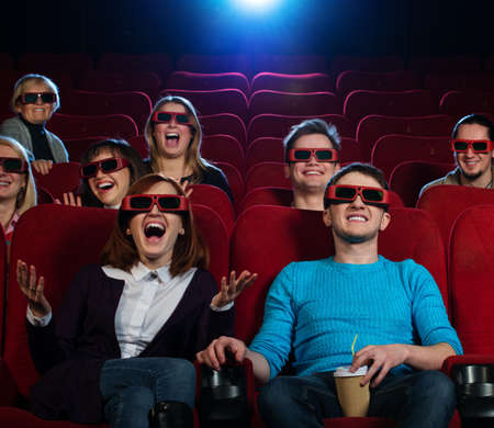 Group of people in 3D glasses watching movie in cinema photo