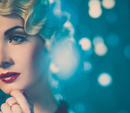 jewelry model: Elegant blond retro woman with beautiful hairdo and red lipstick Stock Photo