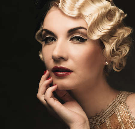 hairdo: Elegant blond retro woman  in golden dress with beautiful hairdo and red lipstick