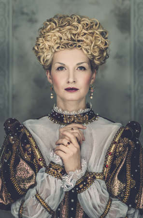 pomp: Picture of beautiful haughty queen in royal dress Stock Photo