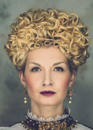 Portrait of beautiful haughty queen in royal dress Stock Photo - 18346299