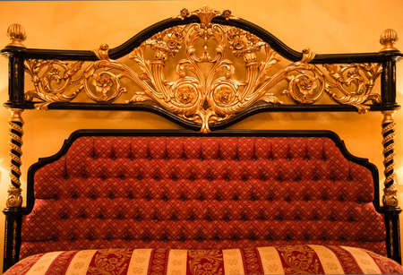 Back of expensive sofa with golden ornament photo