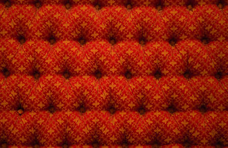 red chair: Close-up view of red luxury upholstery