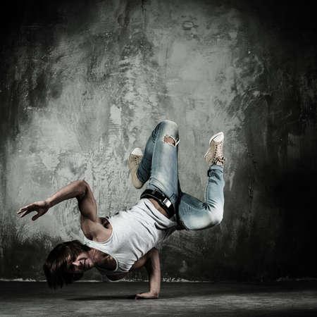 break dance: Young b-boy man doing brake dancing movements  Stock Photo