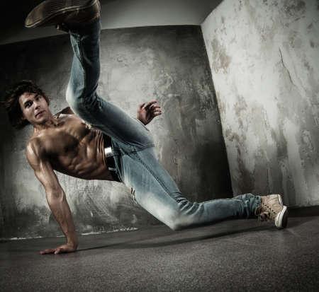 break dance: Young b-boy man with torso doing brake dancing movements  Stock Photo