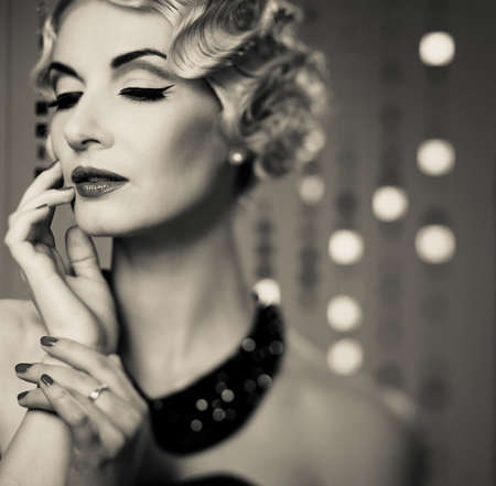 Monochrome portrait of elegant blond retro woman with beautiful hairdo  photo