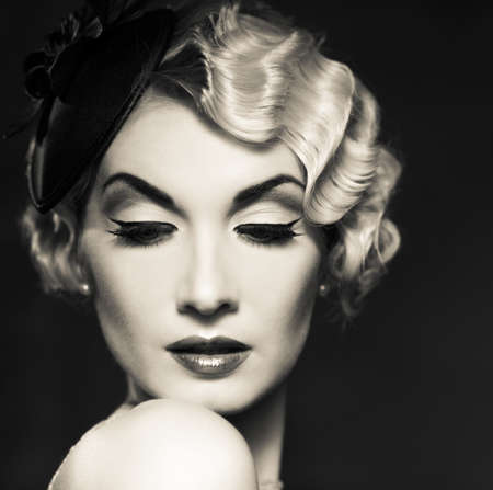 vintage woman: Monochrome portrait of elegant blond retro woman   with beautiful hairdo and little hat