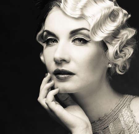 hairdo: Monochrome portrait of elegant blond retro woman   with beautiful hairdo