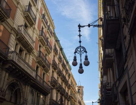 old house facade house: Streetlight on a beautiful street of Barcelona Stock Photo