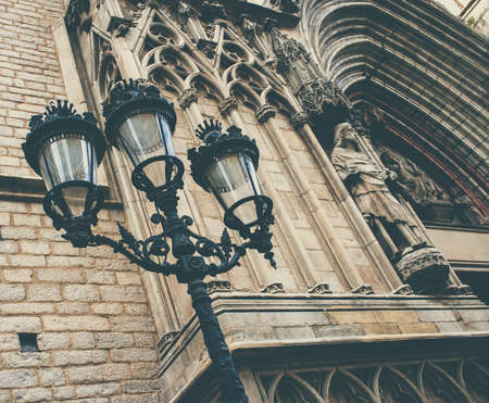 street lamps: Streetlight against cathedral facade with statue