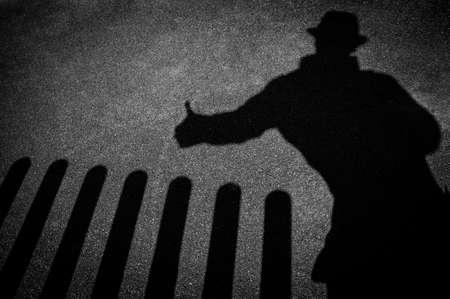Strangers shadow on pavement Stock Photo - 18703403