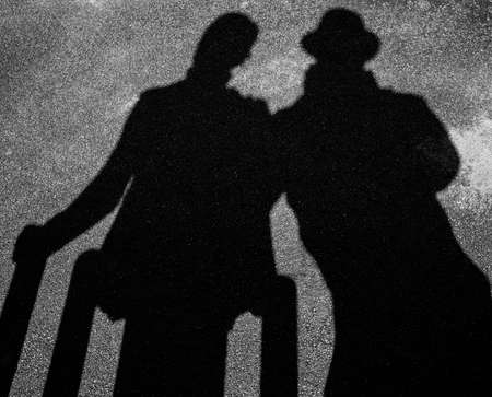 strangers: Two strangers shadows on pavement